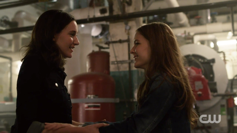 Kara and Alex smile at each other
