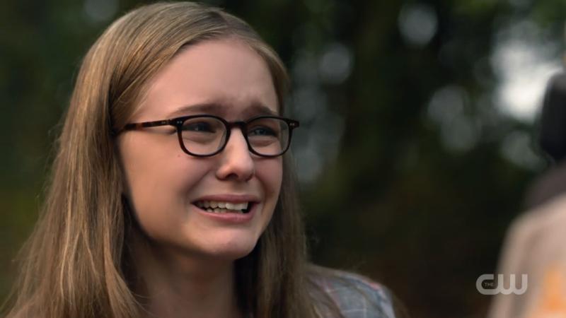Young Kara cries