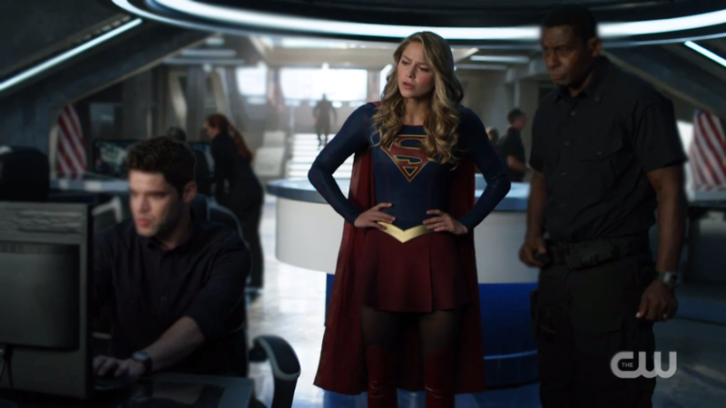 Supergirl stands with her hands on her hips
