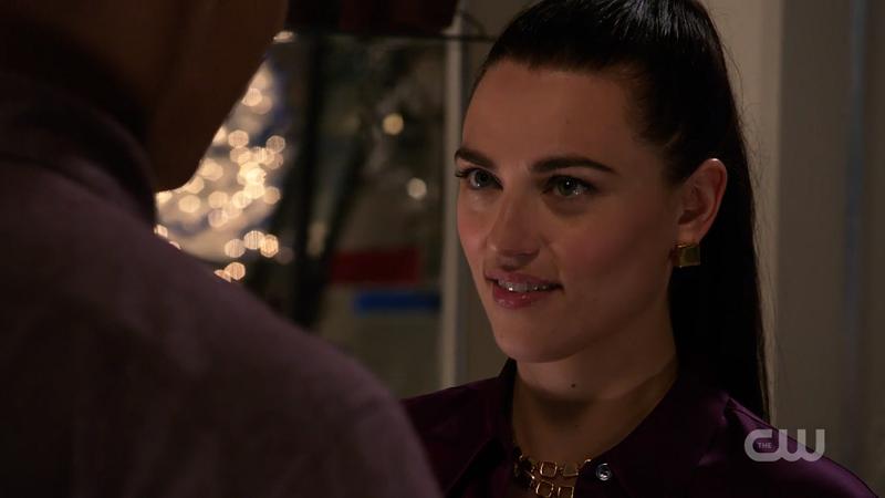 Lena sort of smiles at James