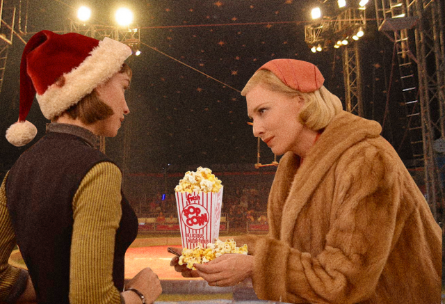 therese and carol at the circus, carol is offering therese some popcorn