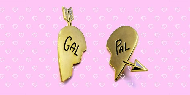 "autostraddle merch gal pal enamel pin set gold heart halves that say ""gal pal"" with an arrow going through"