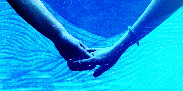 A graphic image of two women's arms holding hands against an ocean-like backdrop