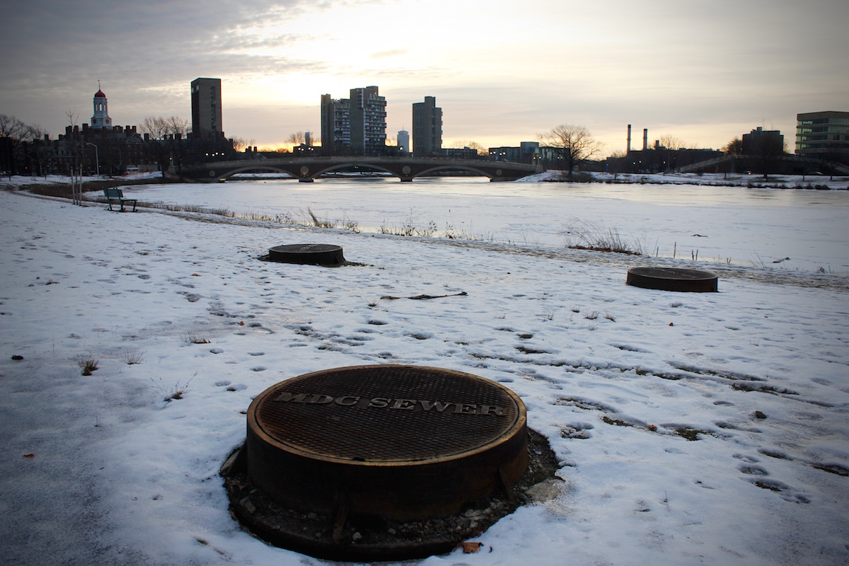 Three sewer manholes near the river.