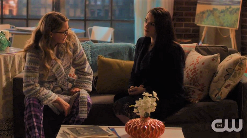Kara slouches on the couch next to Lena