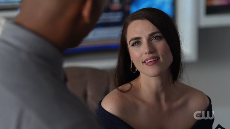 Lena Luthor and her shoulders smile up at James while talking about Kara