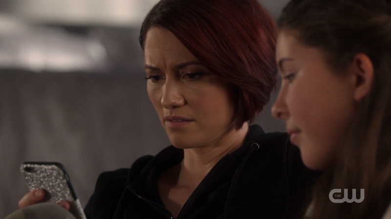 Alex looks angrily at Ruby's phone
