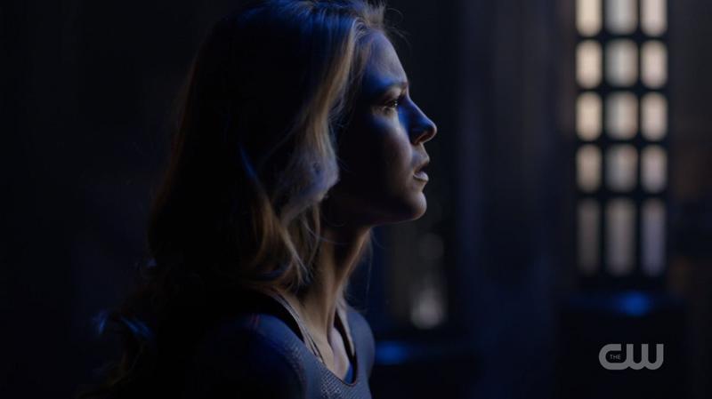 Kara sits up in a blue light