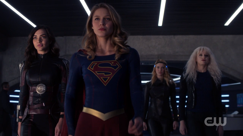Kara, Imra, Psi and Livewire powerwalk out of the DEO