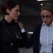 Kara rests a relieved hand on Alex's shoulder