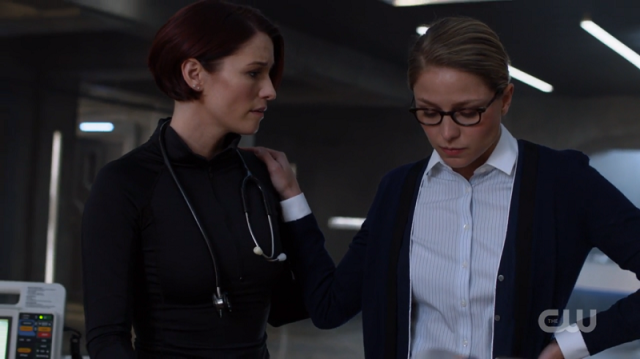 Kara rests a relieved hand on Alex's shoulder