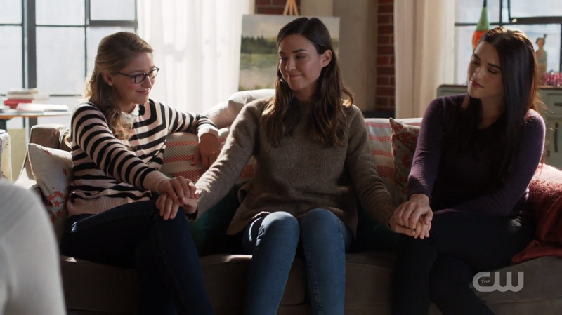 Sam puts her hand on Kara and Lena's knees
