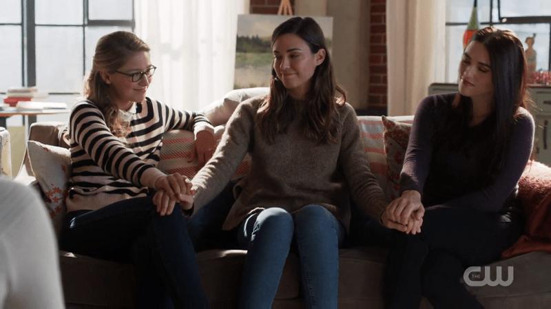 Sam puts her hand on Kara and Lena's knees