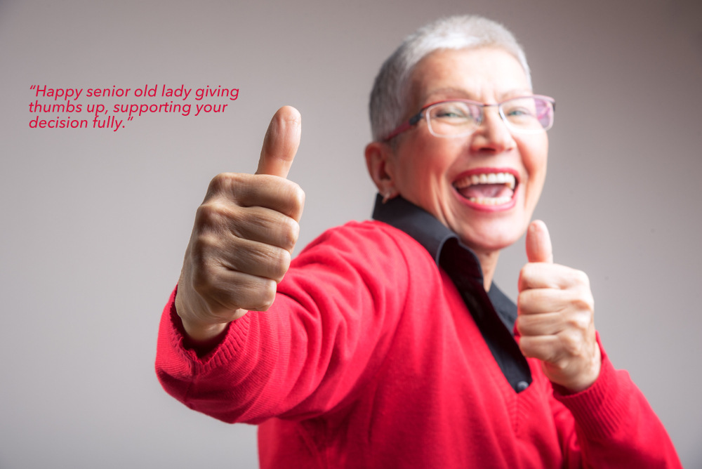 """Happy senior old lady giving thumbs up, supporting your decision fully"""