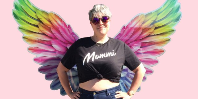 Binky wearing a black Mommi tee with rainbow wings!