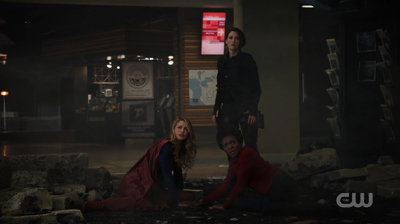 Alex, Supergirl and Julia look at Reign