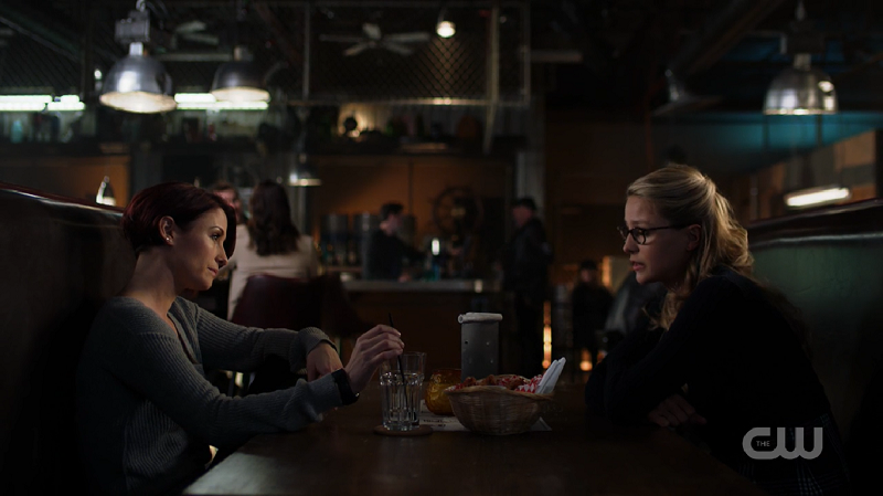 Alex and Kara sit across from each other