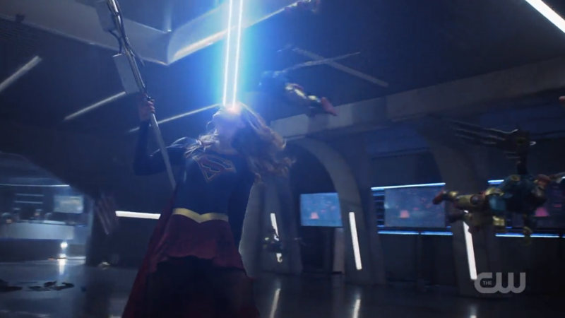 Supergirl uses her heat vision and also the post as a fighting stick