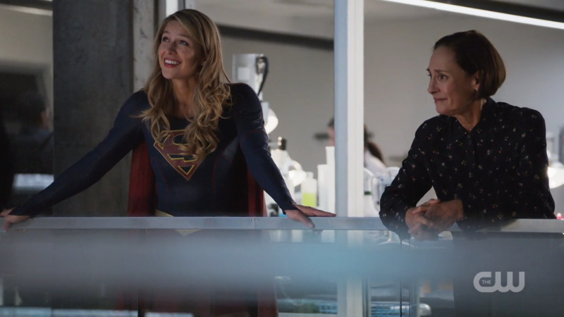 Supergirl and Winn's mom have a chat on the balcony
