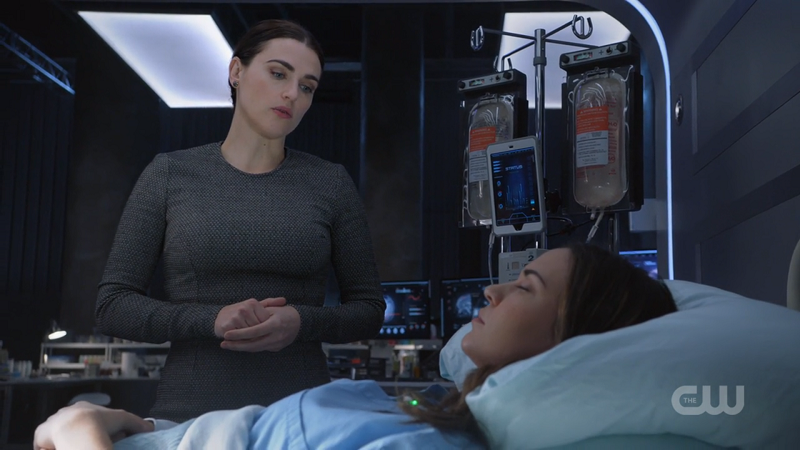 Lena looks over Sam in her hospital bed
