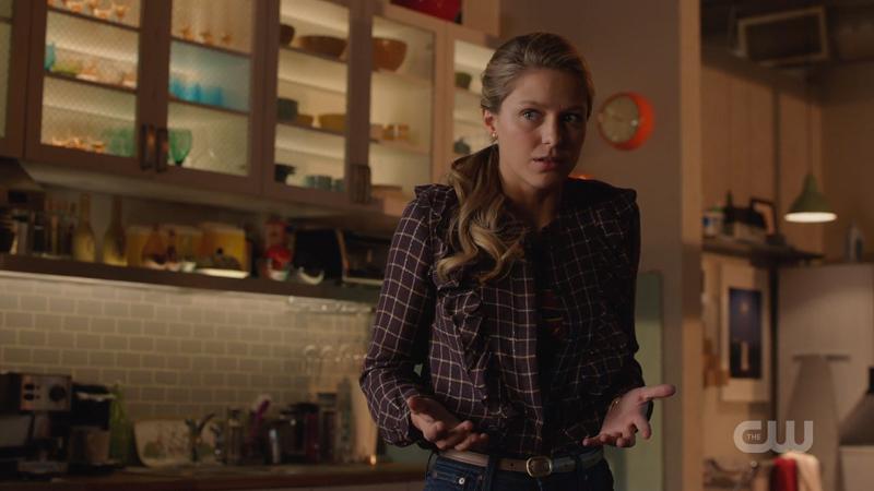 Kara slowly unbuttons her shirt