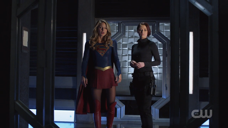 Supergirl and Agent Danvers stand side by side