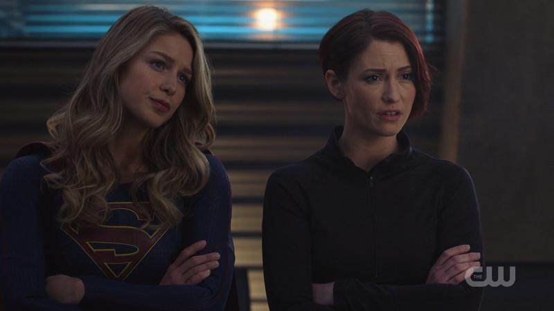 Kara and Alex listen to J'onn intently