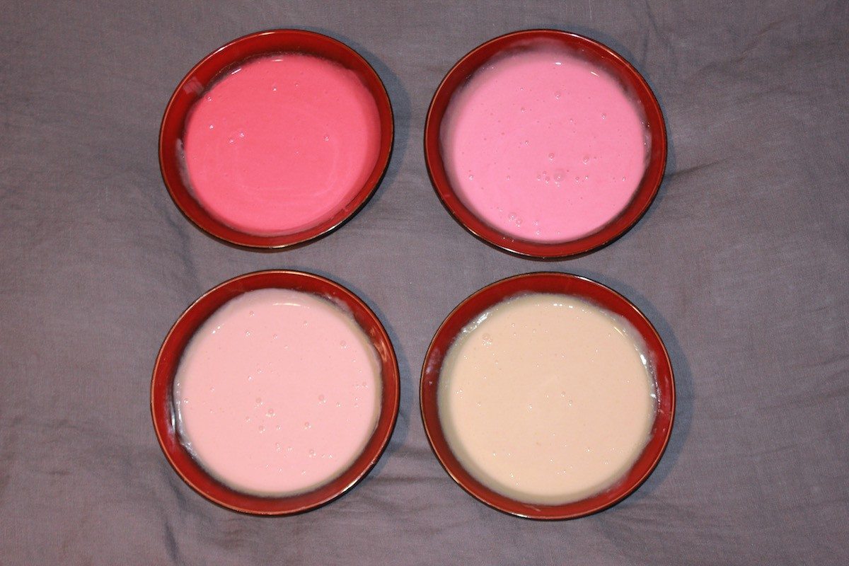 four cakes, various shades of pink