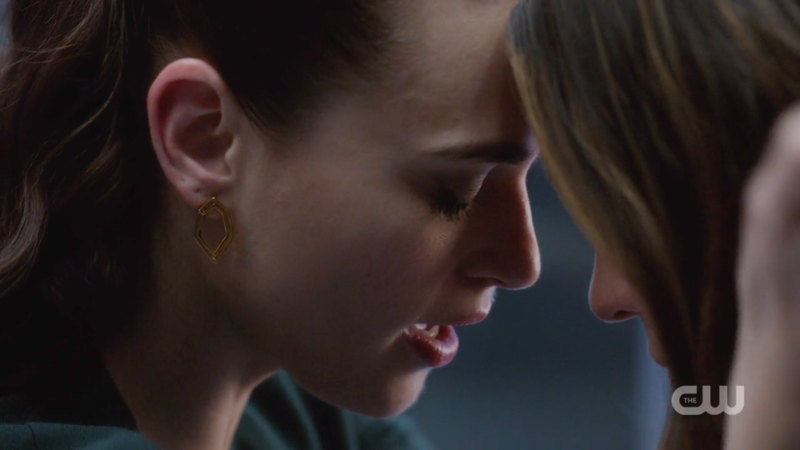 Lena and Sam press their foreheads together