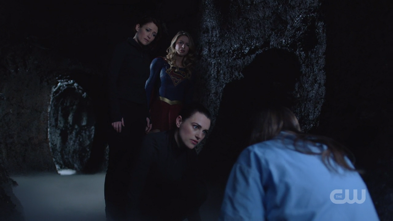 Lena, Alex and Supergirl look down at Sam suportively