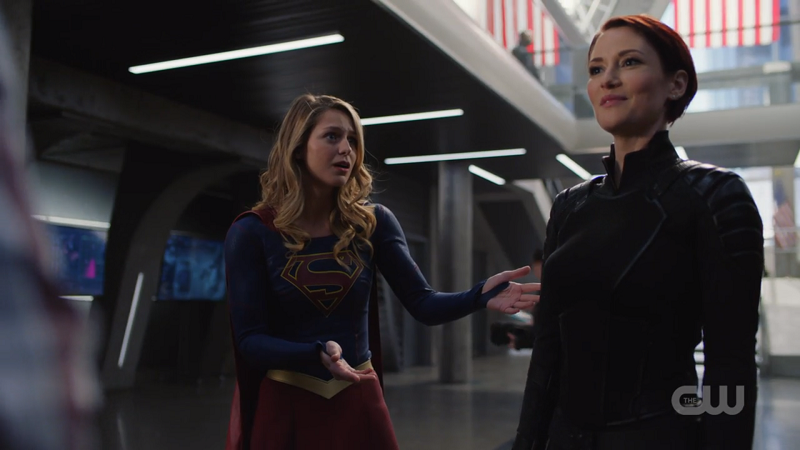 Kara holds her hands out in appreciation of Alex's new suit