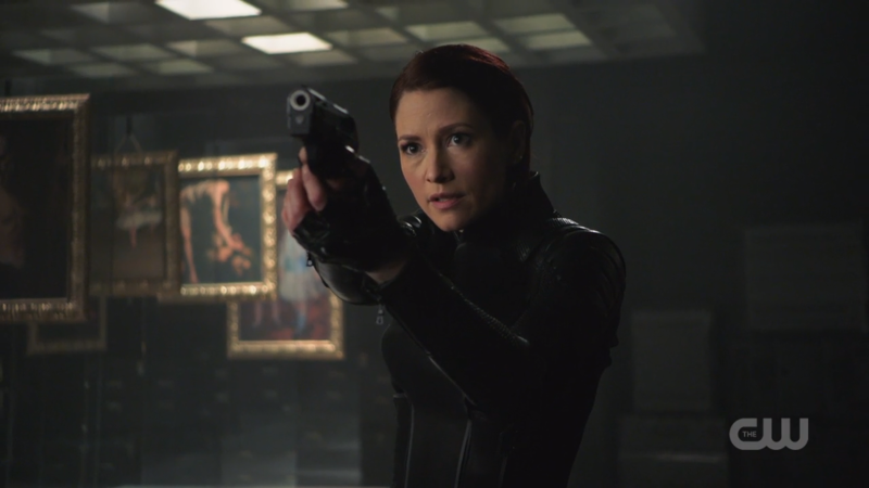 Alex and her new suit and short hair are pointing a gun and i hate guns in real life but this look is a good one
