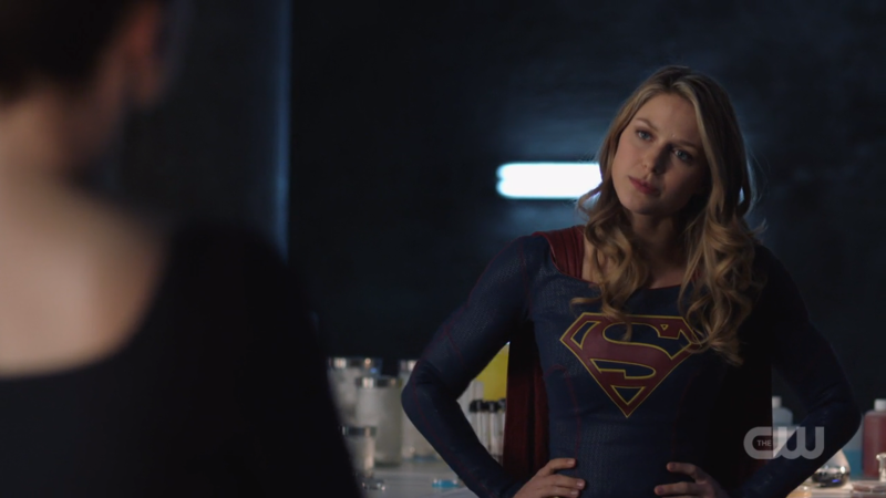Supergirl stands with her hands on her hip, looking salty