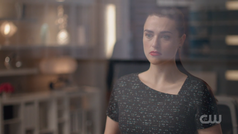 Lena looks wistfully out her window
