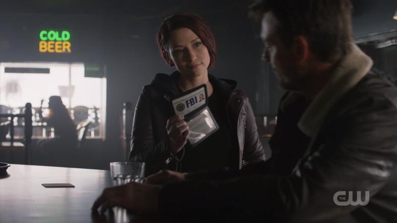 Alex flashes her FBI badge