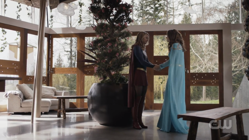 Kara and her mom hold hands in a spacious home