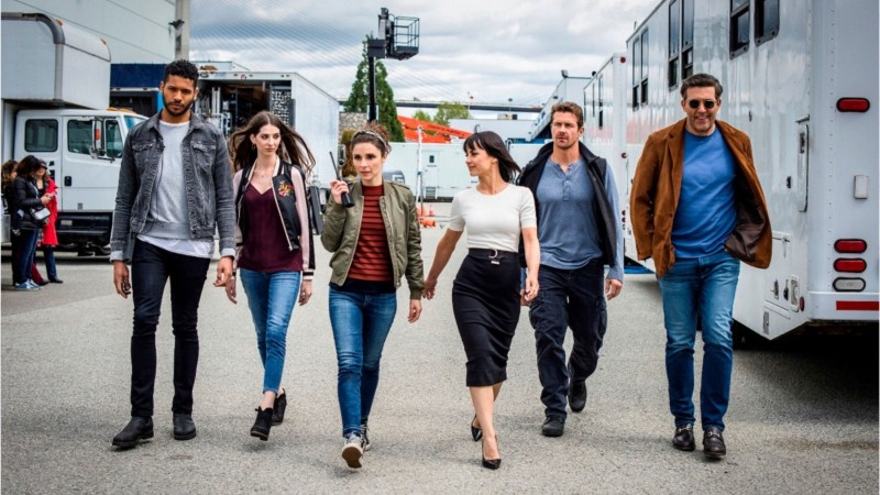 The cast of UnReal walking in the lot