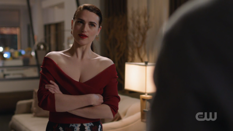 Lena and a low-cut, off-the-shoulder shirt crosses her arms