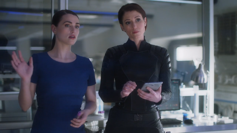 Alex and Lena stand side by side and they just look so good and smart and pretty and gay