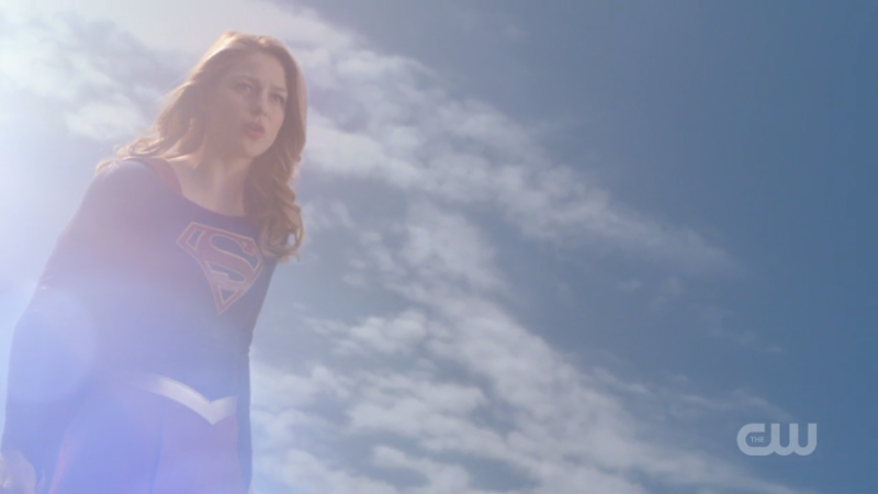 Supergirl flies and quirks an eyebrow at the same time