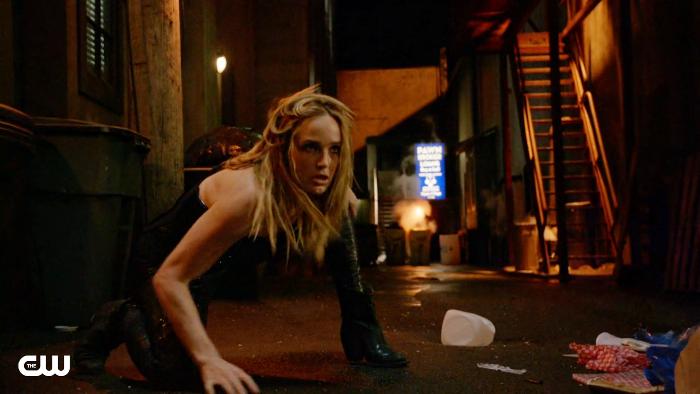 Sara crouches
