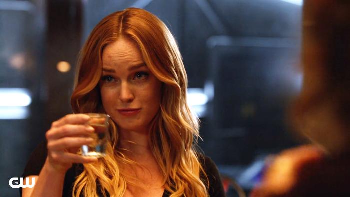 Sara lance toasts a shot glass