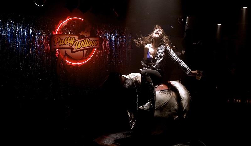 Wynonna Earp on a mechanical bull