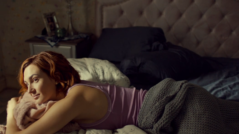Nicole watches Waverly from bed