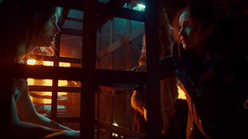 Waverly in a cage, Wynonna outside it