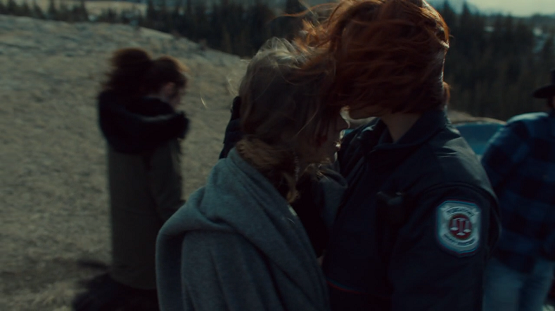 Nicole kisses Waverly on the forehead