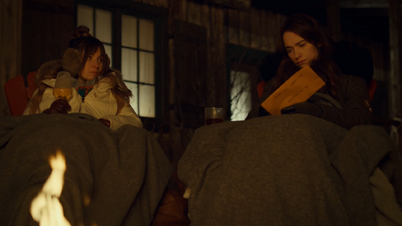 Waverly and Wynonna sit by the fire opening the envelope