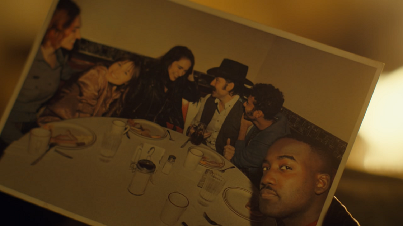the photograph of the whole gang smiling at a diner