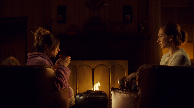 Waverly and Nicole sit by the fire