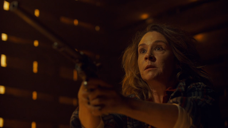 Mama Earp holds up Peacemaker